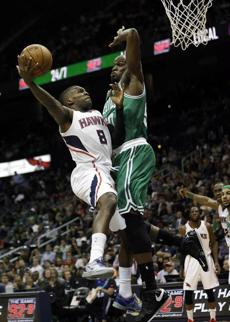 Atlanta's Shelvin Mack put up a shot on Boston's Joel Anthony in the second quarter.